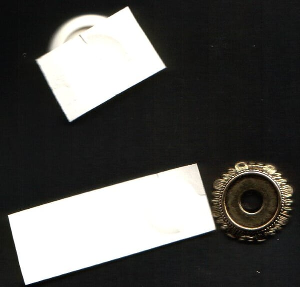 2 place card stock on top press down and make a circle pattern in the paper . cut it out.